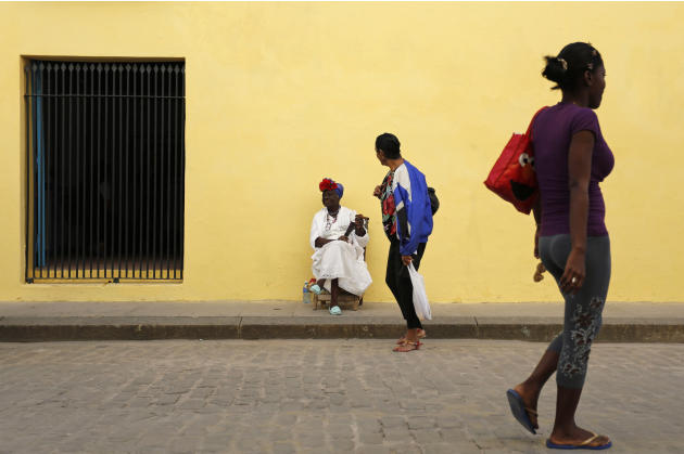 FILE - In this Dec. 19, 2014 file photo - A street entertainer waits for tourists in Old Havana, Cuba. The thawing of U.S.-Cuba relations has inspired many Cubans to think big. Visits by Americans wer