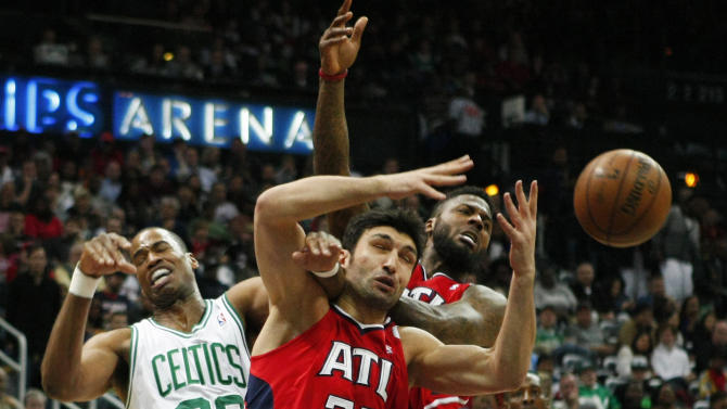 Celtics center Collins along with Hawks  Pachulia and Stevenson battle for a loose ball in the first half of their NBA basketball game in Atlanta