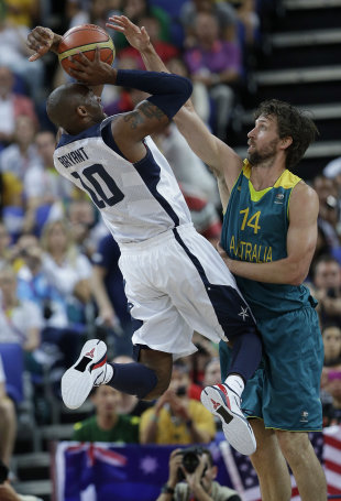 Kobe Bryant (10) puts up a shot as Australia's Matt Nielsen (14) defends on Wednesday. (AP)