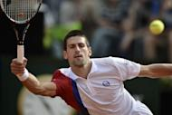 Serbia's Novak Djokovic returns a ball during his quarter-finals match against France's Jo-Wilfried Tsonga at the ATP Rome tournament. Djokovic won 7-5, 6-1