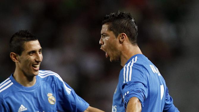 Real Madrid's Cristiano Ronaldo from Portugal celebrates with fellow team members, Angel Di Maria from Argentina, center, after Ronaldo scored a goal against Elche during their La Liga soccer match at the Martinez Valero stadium in Elche, Spain, Wednesday, Sept. 25, 2013