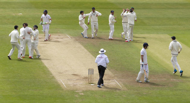 New Zealand's Mark Craig, third left, celebrates with teammates after teammate Kane Williamson catches England's Ian Bell, upper centre left, for 1 on the fifth day of the second Test match be