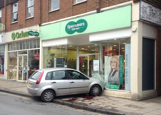 The driver of this car managed to crash into a branch of Specsavers - making the message of the company's advert more poignant (Ben Bridges/Rex Features)