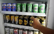 Cans of Tiger beer (top L), brewed by Asia Pacific Breweries, are displayed alongside others, including Dutch beer Heineken, at a convenience store in Singapore on July 27, 2012. Singapore food and beverage group Fraser and Neave (F&N) halted trading Thursday, pending an announcement on the eve of a deadline from Dutch beer giant Heineken to accept its offer for Asia Pacific Breweries