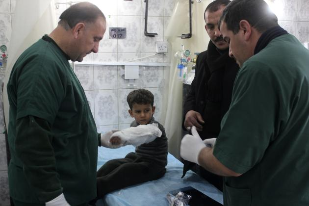 "A boy (2nd L) who was wounded in a bomb attack receives treatment at a hospital in Baquba, about 50 km (31 miles) northeast of Baghdad, January 15, 2014. Bombs hit Iraq's capital Baghdad and a village near the northern town of Baquba on Wednesday, killing at least 59 people, police and hospital sources said, as Prime Minister Nuri al-Maliki warned that militants were trying to set up an ""evil statelet."" In the deadliest incident, a bomb blew up in a funeral tent where mourners were marking the death two days ago of a Sunni Muslim pro-government militiaman, police said. It killed 18 people and wounded 16 in Shatub, a village south of Baquba. REUTERS/Mohammed Adnan (IRAQ - Tags: CIVIL UNREST POLITICS)"