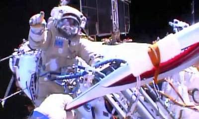 Sochi Olympic Torch In Historic Spacewalk