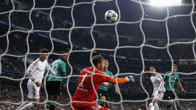Schalke 04's goalkeeper Fahrmann saves a header from Real Madrid's Ronaldo during their Champions League last 16 second leg soccer match in Madrid