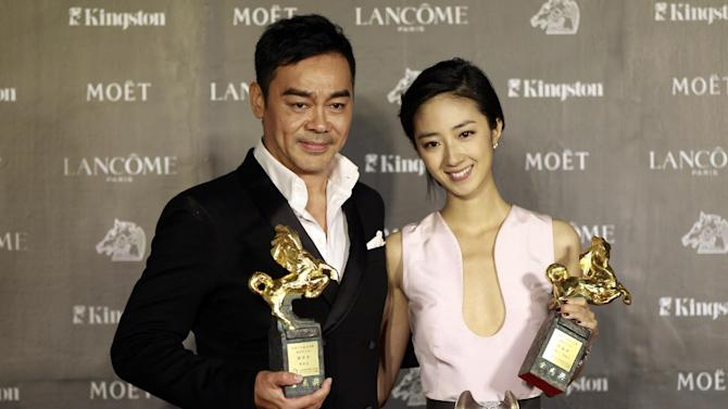 "Taiwanese actress Gwei Lun-Mei and Hong Kong actor Lau ChingWan hold their awards for Best Actress and Best Actor for the film ""GF * BF"" and ""Life Without Principle"" at the 49th Golden Horse Awards at the Luodong Cultural Working House in Yilan County, Taiwan, Saturday, Nov. 24, 2012. The Golden Horse awards are the Chinese-language film industry's biggest annual events. (AP Photo/Wally Santana)"
