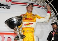 Ryan Hunter-Reay with the Astor Cup after clinched his first IndyCar Series championship with a fourth-place finish in the season-ending race at the Auto Club Speedway track on September 15