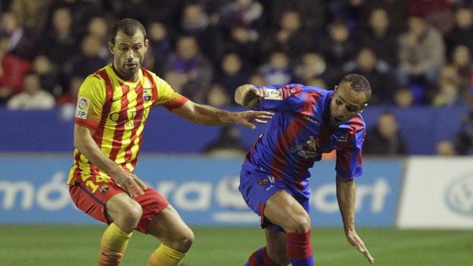 Barcelona's Mascherano and Levante's El Zhar fight for the ball during their Spanish First Division soccer match at the Ciudad de Valencia stadium in Valencia