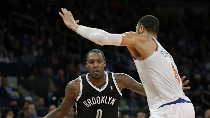 Brooklyn Nets' Andray Blatche, left, tries to move past New York Knicks' Tyson Chandler during the second half of the NBA basketball game at Madison Square Garden, Monday, Jan. 20, 2014, in New York. The Nets defeated the Knicks 103-80