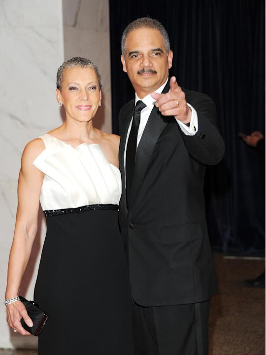 Attorney General Eric Holder and his wife Sharon Malone Holder attend the White House Correspondents' Dinner at the Washington Hilton on Saturday April 27, 2013 in Washington. (Photo by Evan Agostini/