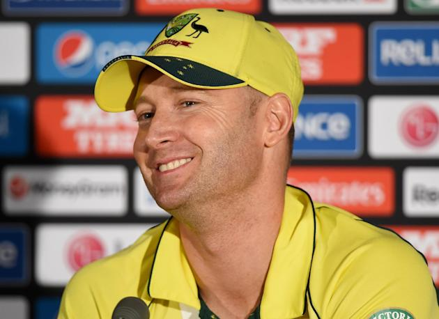 Australian captain Michael Clarke smiles as he answers questions during a press conference following his team's seven wicket win over New Zealand in the Cricket World Cup final in Melbourne, Austr