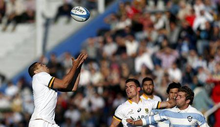 South Africa's Habana tries to catch the ball next to teammate Kriel and Argentina's Cordero during their rugby union test match in Buenos Aires