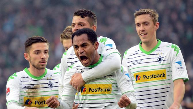 From left, Moenchengladbach's Patrick Herrmann Granit Xhaka,  scorer Raffael and Max Kruse celebrate a goal during the Bundesliga soccer match between Borussia Moenchengladbach and FC Schalke 04 at Borussia-Park in Moenchengladbach, Germany,  Saturday Dec. 7, 2013