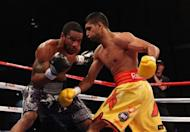 "Lamont Peterson (L) and Amir Khan during their WBA Super Lightweight and IBF Junior Welterweight title fight in 2011. Peterson's camp is ""disappointed and distraught"" by the decision to cancel a world light-welterweight title showdown next week against Khan after the American failed a drug test"