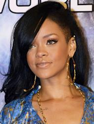 Rihanna (yet again) rocked the red carpet at the premiere of her new film Battleship in Tokyo last night. Almost overshadowed by her fabulous Pucci Pyjama suit, Rihanna's mesmerising, demure outfit complimented her also new and swoonsome beauty style and our sources over at St Tropez let us in on Rihanna's skin secret