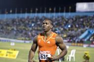 Yohan Blake celebrates after winning the 100m men's final of the Jamaican Olympic Athletic Trials at the National Stadium in Kingston, on June 29. Blake served notice he will be ready to challenge for the Olympic title by upstaging world record holder Usain Bolt to win in 9.75 sec