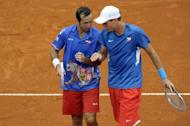 Czech Republic's Tomas Berdych (L) talks with teammate Radek Stepanek during their 2012 Davis Cup semifinal doubles tennis match against Argentina's tennis players Eduardo Schwank and Carlos Berlocq, at Parque Roca stadium in Buenos Aires. Berdych and Stepanek won 6-3, 6-4, 6-3 to give the Czech Republic a 2-1 lead over Argentina