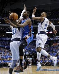 Dallas Mavericks' Brendan Haywood (33) and Shawn Marion (0) defend Oklahoma City Thunder's Kevin Durant, center, during the first half of Game 3 in the first round of the NBA basketball playoffs Thursday, May 3, 2012, in Dallas. (AP Photo/Tony Gutierrez)
