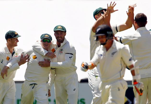 Australia's captain Smith celebrates with team-mates after taking a catch to dismiss New Zealand's Watling for seven runs during the third day of their third cricket test match at the Adelaide
