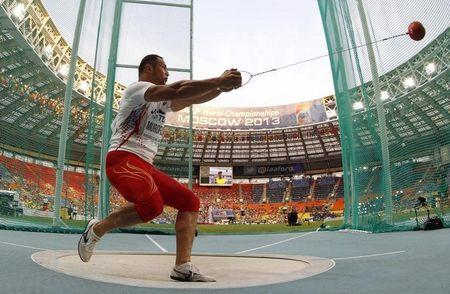 Murofushi of Japan competes in the men's hammer throw final during the IAAF World Athletics Championships at the Luzhniki stadium in Moscow