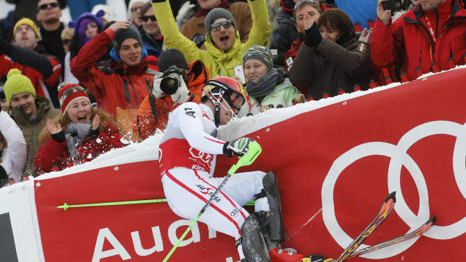 Winner Hirscher of Austria hits the protection fence as he finishes the second run of men's Slalom event of the Alpine Skiing World Cup downhill ski race in Kitzbuehel