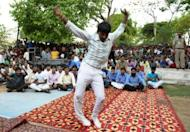 An inmate dances in front of other prisoners to live music during a small concert at the Tihar jail in New Delhi. The event was an unusual break from the daily routine at Tihar jail, where 12,000 inmates ranging from trial suspects to convicted murderers are incarcerated