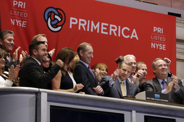 Primerica CEO Glenn J. Williams, second from right, gavels trading closed after the bell at the New York Stock Exchange, Wednesday, April 1, 2015. U.S. stocks closed modestly lower, continuing a downw