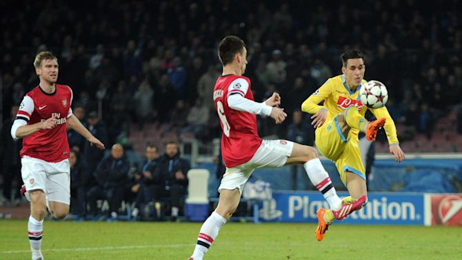 Napoli's Jose Callejon, right, scores during a Champions League, group F, soccer match between Napoli and Arsenal, at the Naples San Paolo stadium, Italy, Wednesday, Dec. 11, 2013. Ten-man Arsenal advanced to the Champions League knockout phase for the 14th consecutive year despite a 2-0 loss Wednesday at Napoli, which was eliminated. Gonzalo Higuain scored in the 73rd minute but the San Paolo stadium was soon silenced when word arrived that Borussia Dortmund had scored a late goal in a 2-1 win at Marseille to win Group F