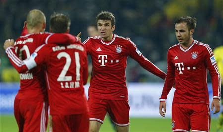 Bayern Munich's Mueller celebrates next to Goetze after Mueller scored a goal against Borussia Dortmund during their German first division Bundesliga soccer match in Dortmund