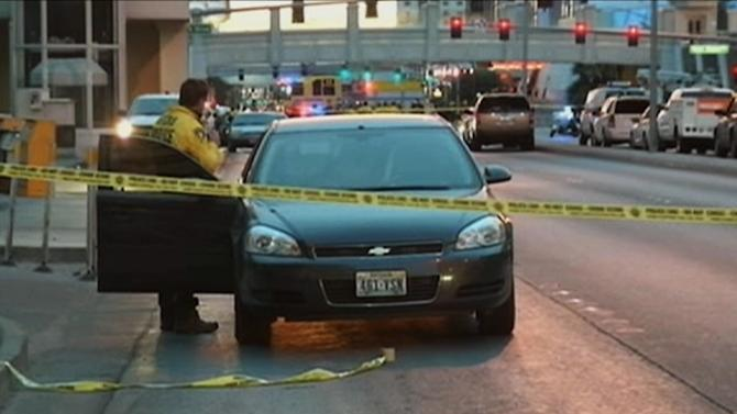 In this still image take from video provided by KTNV, police investigate the scene of a shooting between cars on the Las Vegas Strip early Thursday, Feb. 21, 2013 in Las Vegas. Gunshots fired from a black Range Rover on the Strip early Thursday caused a Maserati to crash into a taxi, creating a fireball and killing three people as the SUV sped away. It's the latest in a series of violent actions on the tourist corridor since the beginning of the year. (AP Photo/KTNV)