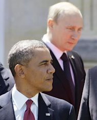 Russian President Vladimir Putin (R) and US President Barack Obama, seen during the D-Day 70th Anniversary ceremonies at Chateau de Benouville in France, on June 6, 2014
