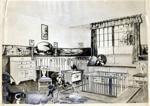 Photo by: Courtey of the Daily MailIn a Daily Mail home-exhibition tour in 1920, designers re-created the nursery of the Queen of Belgium, using toy-hiding curtains, a white crib, and wallpaper printed with adventures.