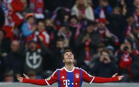 Munich's Goetze celebrates his goal against Braunschweig's during DFB Pokal soccer match in Munich