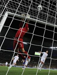 English goalkeeper Joe Hart jumps for the ball during the Euro 2012 football championships match England vs Ukraine at the Donbass Arena in Donetsk. England scraped into the quarter-finals of Euro 2012 here Tuesday after a goal-line refereeing blunder helped them to a 1-0 win over Ukraine which sent the co-hosts crashing out