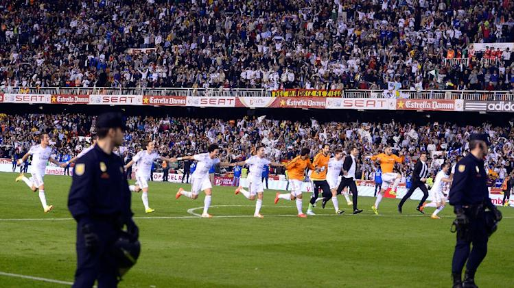 Real Madrid players run celebrating at the end of the final of the Copa del Rey between FC Barcelona and Real Madrid at the Mestalla stadium in Valencia, Spain, Wednesday, April 16, 2014. Real defeated Barcelona 2-1
