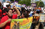People protest in front of the US Supreme Court as it hears arguments on Arizona's controversial immigration law