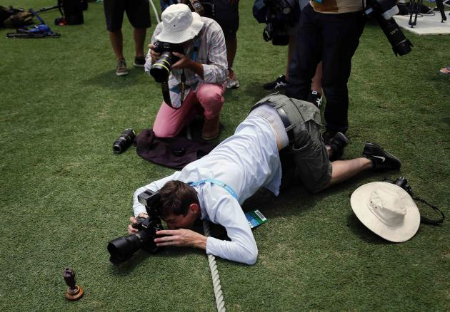 Photographers take pictures of a replica Ashes urn in Brisbane