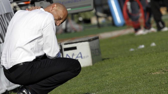 Chievo's coach Domenico Di Carlo reacts at the end of the Serie A soccer match against Siena at the Artemio Franchi stadium in Siena, Italy, Sunday, Oct. 30, 2011. Siena won 4-1. (AP Photo/Paolo Lazzeroni)