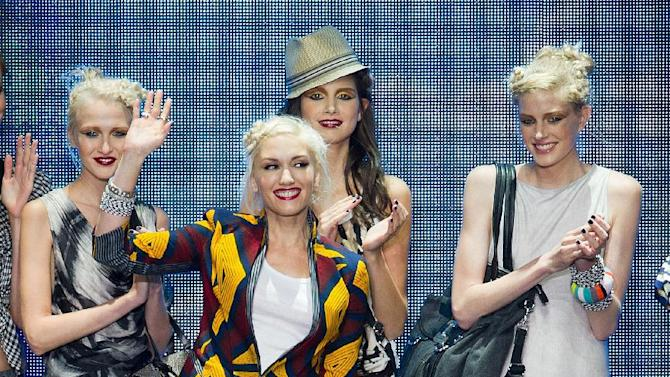 FILE - In this Sept. 16, 2010 file photo, Gwen Stefani is joined by her son Kingston on the runway after her L.A.M.B. fashion show held during Mercedes-Benz Fashion Week in New York. Stefani is no stranger to multitasking, juggling her music career _ she's wrapping up a new album with No Doubt _ and her fashion projects, which include the debut of the newest Harajuku Mini collection at Target next week.  (AP Photo/Charles Sykes, file)