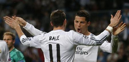 Real Madrid's Ronaldo celebrates with teammate Bale after scoring a goal against Schalke 04 during their Champions League last 16 second leg soccer match at Santiago Bernabeu stadium in Madrid