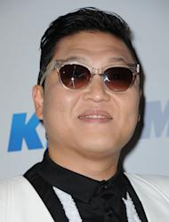 FILE - In this Monday, Dec. 3, 2012 file photo, PSY arrives at KIIS FM's Jingle Ball at Nokia Theatre LA Live, in Los Angeles. President Barack Obama still intends to attend a charity concert where PSY is scheduled to perform after reports the South Korean rapper participated in anti-American protests several years ago. (Photo by Katy Winn/Invision/AP, File)
