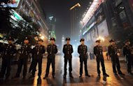 File photo shows Chinese police standing guard in Chongqing. In China, police can sentence petty criminals to labour camps without trial, a practice widely criticised by rights groups, as well as the United Nations