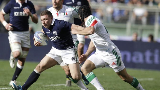 Scotland's Duncan Weir, left, is chased by Italy's Angelo Esposito during a Six Nations rugby union international match between Italy and Scotland, in Rome, Saturday, Feb. 22, 2014. (AP Photo/Andrew Medichini)