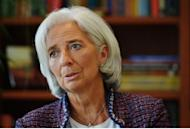 Christine Lagarde speaks in an interview with AFP at IMF Headquarters in Washington, DC last month. The IMF chief signalled on Sunday that her organisation would be lowering slightly its global economic growth forecasts, which are set to released in the next few days.
