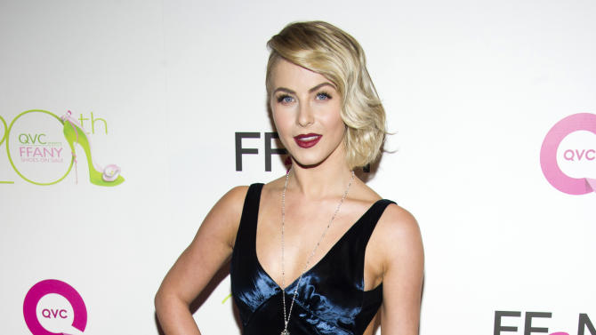 """FILE - This Oct. 1, 2013 file photo shows actress Julianne Hough at the 20th Annual """"FFANY Shoes on Sale"""" Gala presented by QVC and FFANY in New York. Hough apologized on Twitter amid criticism for darkening her skin for a costume as Crazy Eyes from """"Orange is the New Black"""" at a Hollywood bash. (Photo by Charles Sykes/Invision/AP, File)"""