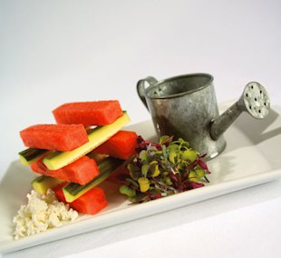 For a luscious summer salad, pair watermelon and cucumber with feta cheese and fresh baby greens.