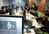 Thai children take part in a training session of a computer animation program provided at a school in Bangkok, May 6, 2006. Thailand plans to distribute about 1.7 million tablet computers to students and teachers this year in the world's largest handout of the devices for education, officials said Thursday