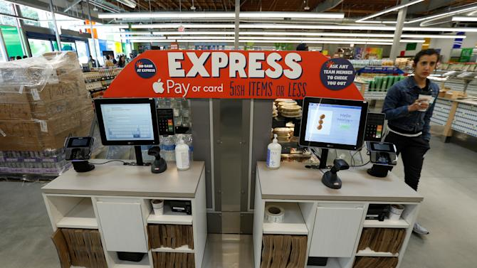 Express cashier kiosks are pictured at a 365 by Whole Foods Market grocery store ahead of its opening day in Los Angeles